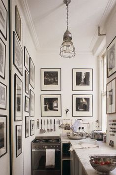 Galley kitchen done well. I like all the pictures on the walls for character White Kitchen, Tiny Kitchen, Kitchen Design, Small Galley Kitchens, Home Kitchens, Small Kitchens, French Kitchens, Small Bathrooms, Black Kitchens, Sweet Home, Cozy Kitchen, Narrow Kitchen