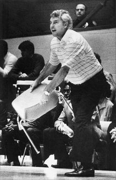 Bobby Knight handing the chair to the elderly lady.