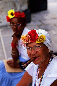 Portrait of cigar-smoking Cuban woman in Plaza de Armas, Havana