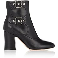 """Crafted of black leather, Gianvito Rossi's side-zip ankle boots are styled with a rounded toe, double buckle straps, and chunky block heel. 3.25\""""/85mm heel (a…"""