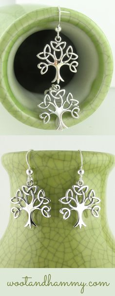 Branches intertwine to become perfectly symmetrical Celtic knots in these shimmery, dangling tree of life earrings. See it at www.wootandhammy.com.