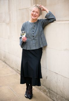 Actress Mandy Godfrey, swears by this outfit for interviews. Crop Summer shirt in striped cotton and Crenelated Skirt in Wool.