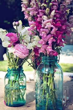 Blue mason jars for centerpieces are a very elegant choice for a rustic wedding.