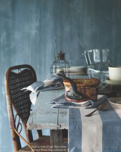 Rustic blue-gray table in front of blue-gray wall and decorated with blue and white runner and organic items. Love the chair. Rustic Blue, Country Blue, French Country Style, Grey Table, Wide Stripes, Food Styling, Soft Furnishings, Interiores Design, My Favorite Color