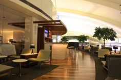 Gaze at views of the airfield and the Hollywood hills at the chic Star Alliance Lounge at LAX. Complimentary refreshments and cocktails are available at the serviced bars, and shower suites help travelers freshen up before flights.
