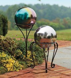 "Stainless Steel Weather-Resistant Gazing Ball with Iron Scroll Stand . $45.95. Stainless Steel Weather-Resistant Gazing Ball with Iron Scroll Stand. Our rust-resistant, powder-coated Iron Ground Stake looks elegant with our unbreakable, weather-resistant Stainless Steel Gazing Balls. Available Colors Blue Mystic Red Silver Size Gazing Ball 10"" dia. Ground Stake 24""H Scroll Stand 12""H"