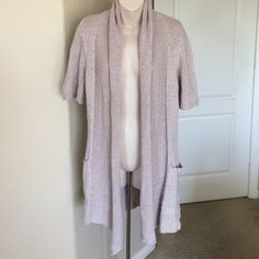 ♣️ Anthropologie Sparrow s sleeve long cardigan This is a perfect spring Anthropologie short sleeve cardigan. It is a light lavender and size small. It's a nice knitted sweater 90% cotton 10% wool. Worn a few times.  All items are from a clean, smoke free home  Please use the offer button... We will not answer ? on price in the comments.   Trades  Modeling Anthropologie Sweaters Cardigans