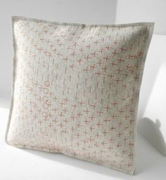 Felt pillow with orange stitching. #sew #embroidery