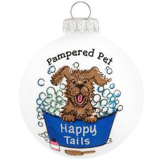 """Looking for a gift to make a splash with your favorite animal groomer or pampered pet? Exclusively crafted for Bronner's, this ornament has the matte white surface awash with a bathing pooch popping up from a bucket of suds beneath the playful sentiment """"Pampered Pet"""". Allow one of our professional Bronner's artists to add a personalized touch with a silver paint pen at no additional charge. Simply put, our pampered pet ornament is good-clean-fun for many years to come!"""