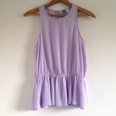 Lavender peplum top with keyhole back Buttons lavender peplum top with keyhole back. Sweater is also for sale, would like really cute with a long statement necklace! Size medium. Bundle to save! Tops Blouses