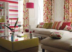 Add colourful cushions to brighten up a plain sofa (Harlequin Anouska Fabric)