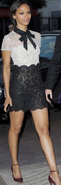 Who made  Zoe Saldana's jewelry, pumps, black and white scallop lace bow dress that she wore in Cannes?