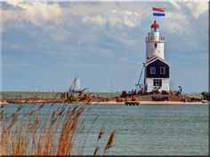 Der  Leuchtturm  von Marken/  Holland  - Paard van Marken