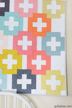 Plus and Minus quilt pattern by Emily of Quiltylove.com. Modern plus quilt is a beginner friendly quilt pattern. Use a layer cake, jelly roll or fat quarters. #plusquilt #modernquilting #quiltylove