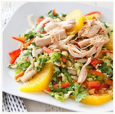 Chinese Chicken Salad | Cook's Country | Crisp romaine lettuce and Napa cabbage, bell peppers, fresh cilantro, and scallions. Poachec boneless, skinless chicken breasts in a flavorful mixture of soy sauce, orange juice, rice vinegar, and ginger. Finished with a bold orange-ginger dressing with orange segments and crunchy roasted peanuts. #Chinese #chicken #oranges #salad #recipe