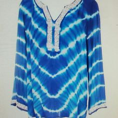"""-Tie-dye embellished tunic-NWT Beautiful shades of blue and turquoise...just like the Caribbean!  White (sewn on) beads around each sleeve and sexy neckline.  Pit to pit, 24', back neck to hem, 28"""".  Fabric has a slight crinkle and is 100%  rayon. International concepts Tops Tunics"""
