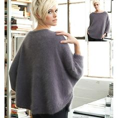 """Dolman sleeves and draping are always in vogue. JEANNIE CHIN works her beautifully draped pullover from the curved lower edge up, using Schulana/Skacel Collection's touchable """"Angora Fashion."""""""