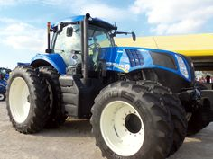 New Holland tractor with front & rear duals New Holland Ford, New Holland Tractor, New Holland Agriculture, Ford News, Heavy Equipment, Vehicles, Church Ideas, Pictures, Farms