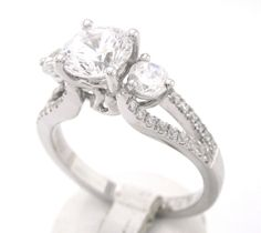 Round cut diamond engagement ring three stone