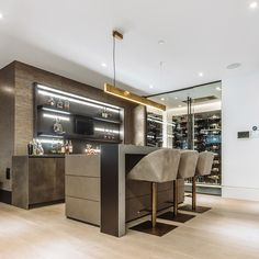 had carte blanche with the interior of a client's home. They made it fashion-forward and edgy with specialized millwork and high-end detailing. Bar Interior Design, Küchen Design, House Design, Interior Colors, Modern Home Bar Designs, Modern Bar, Contemporary Bar, Home Bar Rooms, Home Bar Decor