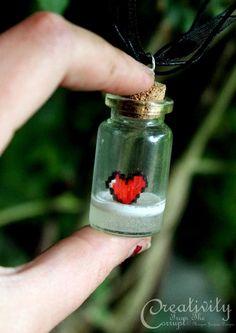8 Bit Heart Zelda Vial Necklace by CreativityFTCorrupt.deviantart.com