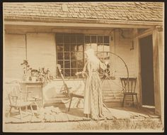 Lady with spinning wheel, Waterford, Vermont | Wallace Nutting photographic collection, 1910s-1930s (PC039) -- Historic New England