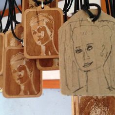 """Just went through some older photos and found this one that made me smile. To the right is my """"artistic"""" pendant prototype in cardboard and to the left the final one in wood. The photograph which is engraved is an image if a mannequin I took in Melbourne. All our laser engraved pendants are now on sale. www.dirtbyearth.com"""