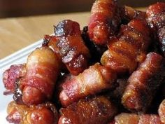 bacon wrapped lil' smokies in a brown sugar and maple glaze - these are beyond amazing! plan on making at least package per person because you seriously cannot just have one ;)