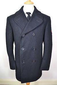A CLASSIC AMERICAN MILITARY WOOL PEA COAT.    Item Description:        A MEN'S UK LARGE 42 LONG (detailed measurements given below). Black colour. Six buttons - all with anchor symbol and original). Collar and lapel. Two slit pockets at the waist. Black coloured lining, upper half quilted. Made from Wool. Genuine US Naval military grade and quality. Excellent condition for it's age and a truly excellent winter overcoat. Dry cleaned and steam pressed before being listed.