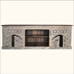 1. Frosted Palace Tropical Hardwood Hand Carved Media Center