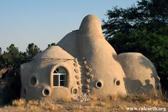 Cal-Earth genius idea.  Houses made by soil and lime are cheap, easy to build and very, very durable.