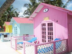 Candy coloured beach huts in the Bahamas #SummerofBoux