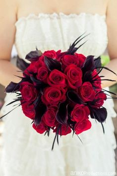Red roses, black callas, a touch of black feathers by Floral Sunshine