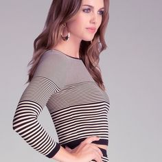 Bebe striped crop top Actual color is the creme/black. Other model photo is there to just show the fit. Bodycon top.92% nylon, 8% spandex bebe Tops Crop Tops