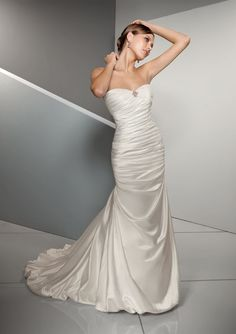 form fitting lacey wedding dresses   This form fitting bridal gown features a removable brooch at the ...