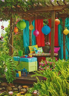 "How ""fun"" and happy looking.  So simple with plastic shower curtains, a box with a cushion.  Make a bench - with cushion.  And then the biggest touch for the atmosphere - the Chinese lanterns"