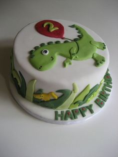 Dinosaur birthday cake by Bath Baby Cakes, via Flickr