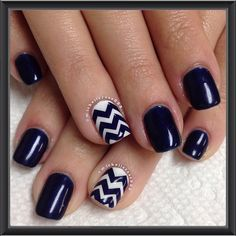 Navy nails with chevron accent. Would do this with a pinkish nude color instead of white.