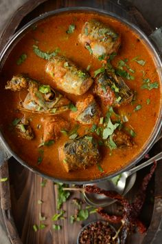 Maharashtrian Bangdyache Ambat Kalwan (Spicy Mackerel Curry with Coconut and Tamarind) - a traditional seafood preparation from Maharashtra, India - thespiceadventuress.com