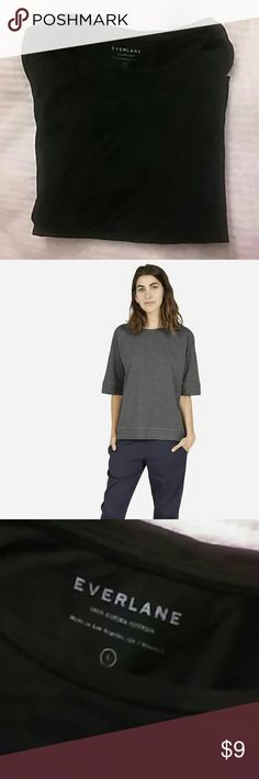 Everlane Cotton Texture Tee in Black Size L Everlane texture tee, made of 100% Supima cotton. The listing is for a BLACK tee (grey top in photo is to show fit only). Size large but runs big. Somewhat faded but otherwise great condition. See Everlane listing for full measurements and details: https://www.everlane.com/products/womens-texture-tee-dark-grey?collection=womens-tees Everlane Tops Tees - Short Sleeve