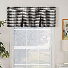 Add class to any window with this black-and-white pleated valance. With a classic, pleated design and houndstooth pattern, this valance will go well with a variety of decorating schemes. Both the valance and lining are made from 100 percent cotton.