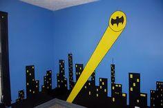 boys Batman bedroom. Cityscape painted on walls