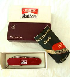 Collectors Marlboro Victorinox Swiss Army Knife, in original box with instruction pamphlet. Knife features several appliances.
