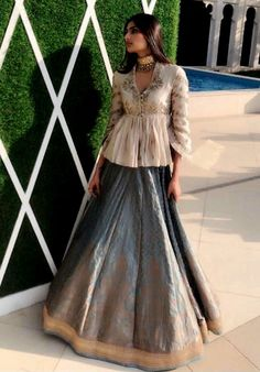 Beautiful Silk peplum hand embroidered blouse and silk skirt. Choli Blouse Design, Choli Designs, Lehenga Designs, Saree Blouse Designs, Indian Attire, Indian Ethnic Wear, Indian Wedding Outfits, Indian Outfits, Indian Designer Outfits