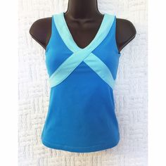 """Lululemon Tank Lululemon blue and aquamarine cross stripe tank.  In preowned condition, has fading and small bleach dot on front collar area shown in the last photo.  No cracks in the logo.  There are 2 small nicks under the """"wet dry warm"""" tag inside, doesn't affect the outside.  Has a built in lining for the chest area; not padded.  Size tag has been removed but it's a size 2.  No trades/modeling. lululemon athletica Tops Tank Tops"""