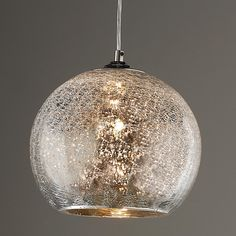 "Crackled Mercury Bowl Pendant Light Thanks to the mercury and crackled glass bonding together, you're left with a magnificent look of diamonds in your ceiling whether it's lit or not. The glass sparkles so spectacular and gives off a pricey look without breaking the bank. Comes with 7' clear cord and chrome hardware. Single 60 watt (candle base socket). Glass measures approximately 9.5""H x 9.5""W."