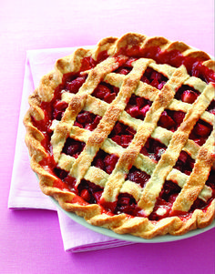 Homemade Strawberry Rhubarb pie is filled with fresh fruit in pie crust made from scratch. This is a great recipe for a 4th of July party!