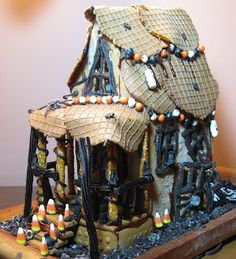 A Halloween Gingerbread House? And while you're at it, why not make it a haunted gingerbread house with spooky lights shining ou. Halloween Gingerbread House, Make A Gingerbread House, Christmas Gingerbread House, Halloween House, Fall Halloween, Halloween Party, Haunted Halloween, Happy Halloween, Gingerbread Village