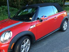 Red convertible MINI Cooper with Union Jack side-view mirrors in Southport CT. #cars #mini #minicooper #ct #connecticut #southportct #newengland #unionjack #british