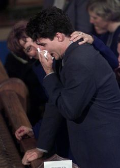 Justin Trudeau is consoled by his mother Margaret after reading the eulogy for his father,
